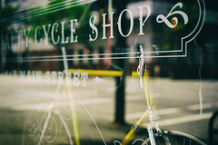 """Cycle Shop"" (Eric Flexyourhead) Tags: vancouver canada britishcolumbia bc mainstreet downtowneastside dtes superchampioncycleshop superchampionspecialtycycleshop city urban detail fragment shop store window display glass reflections bike bicycle shallowdepthoffield bokeh sonyalphaa7 zeisssonnartfe55mmf18za zeiss 55mmf18"