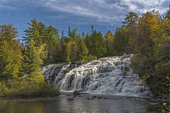 Bond Falls in the Upper Peninsula of Michigan (Daniel000000) Tags: bond falls waterfall waterfalls michigan mi up upper peninsula dslr slr nikon d750 trees fall autumn green colors sky clouds blue sunny water river