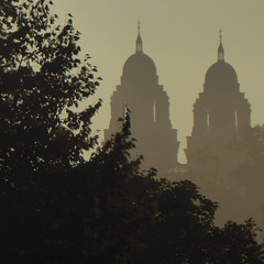 Cathedral spires on a foggy evening (yooperann) Tags: marquette upper peninsula michigan cathedral fog mist golden light church catholic