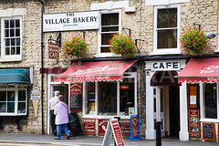 FOT1195376 (simonzohhadi2) Tags: travel uk united kingdom gb great britain england yorkshire north york moors english village kirkbymoorside bakery cafe restaurant old people couple visiting sandwich bar icecream ice cream shop horizontal