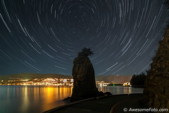 Startrails with Siwash Rock (james c. (vancouver bc)) Tags: abstract arcs art astronomic astronomy astrophotography celestial circle exploring harmony idyllic landscape motion mountain nature night north polaris reflect sea inlet water city lights rotation science serene serenity silhouette sky space star starry startrails traces trails tranquil tranquility tree universe canada landmark attraction seawall vancouver shoreline britishcolumbia stanleypark siwashrock foreground
