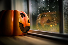 Happy Halloween! (Nicholas Erwin) Tags: halloween pumpkin window reflection rain water waterdrops scary contrast windowlight orange nikon d610 5018g nikkor fav10 fav25 fav50