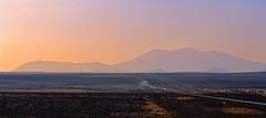Trains meet west of Winslow, AZ (rolfstumpf) Tags: winslow usa sunset arizona santafe sanfranciscopeaks railway railroad desert landscape dusk evening fujichrome astia