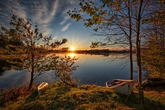 Vormedalsvatnet, Norway (Vest der ute) Tags: xt2 norway rogaland karmøy vormedal water waterscape landscape lake reflections boats trees grass tree sunrise sunstar fall autumn earlymorning sky bluesky clouds outdoor serene fav25