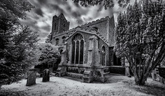 In the churchyard (David Feuerhelm) Tags: blackandwhite bw noiretblanc schwarzundweiss contrast wideangle infrared ir church tower clouds window silverefex nikon d90 sigma1020mm