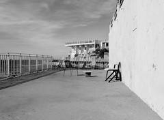 Boudoir de plage (ZUHMHA) Tags: marseille france monochrome chair chaise fence grille grillage barrière soleil sun ombre lumière light shadow line ligne courbe curve geometry géométrie water sea mer eau sky ciel nuages cloud mur wall letter lettre sign