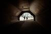 Exit (Adventures in Infrared) (Torsten Reimer) Tags: park trees unitedstatesofamerica walking manhattan infrared northamerica nyc newyorkcity couple newyork centralpark tunnel infrarot usa olympusepl5 unitedstates us