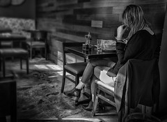 Alone (DmitryXT1) Tags: woman restaurant phone waiting eating bw loneliness hair beauty