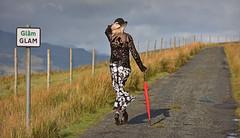 Glam.. (Harleynik Rides Again.) Tags: glam isleofraasay glamour glamor highlands scotland westcoast woman parasol backshot heels harleynikridesagain