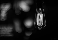 Black Light (lǝᴉuɐp) Tags: canoneos6d canon eos 6d canonfl55mmf12 canonfl55mm canonfl 55mm 55mmf12 f12 grandrapidsmichigangrandrapids michigan lightbulb filament bright glowing hot bulb light shine electric electricity blackandwhite blackwhite bw