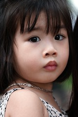 A cute little Vietnamese girl, Ho Chi Minh City, Saigon, Vietnam (adamba100) Tags: asia asian china chinese korea korean mongolia mongolian vietnam vietnamese thai beijing town city view landscape cityscape street life lifestyle style people human person man men woman women male female girl boy child children kid interesting portrait innocent cute charm pretty beauty beautiful innocence play face headshot pure purity tourism sightseeing tourist travel trip light color colour outdoor traditional cambodia cambodian phnom penh sony a6300 18105 siem reap pattaya bangkok field gate architecture