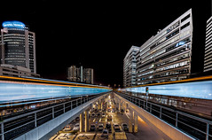 Train In - and Out-going (mcalma68) Tags: amsterdam train station sloterdijk lighttrails speed night hdr offices buildings architecture