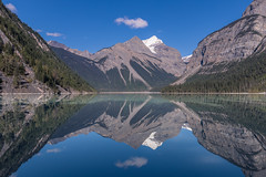 Kinney Lake (robertdownie) Tags: sky water reflection clouds rock snow ice mirror blue still cliffs symmetry tranquil wilderness tranquility remote backcountry forest canada lake mountains bc british columbia kinney mt robson provincial park