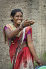 The gesture (Photosightfaces) Tags: indian girl saree red india pune gesture laugh smile happy