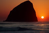 Pacific City Sunset (Ian Sane) Tags: ian sane images pacificcitysunset haystack rock cape kiwanda pacific city oregon coast ocean beach sunset sun sky tones wave splash canon eos 7d camera ef100400mm f4556l is usm lens