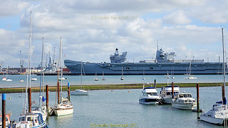 Queen Elizabeth Supercarrier as seen from the walk from the Explosion Museum, one of the attractions at the Portsmouth Historic Dockyard in September 2017, Portsmouth, Hampshire, England.