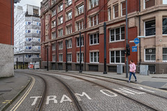 A nonautos street with an Englishman in a pink sweatshirt. (Tim Kiser) Tags: 2017 20170810 august august2017 balloonstreet balloonanddantzic dantzicstreet dantzicandballoon england greatbritain img4994 manchester manchesterengland manchestermetrolink manchestercitycenter manchestercitycentre manchesterstreetscape metrolink metrolinktracks northwestengland only uk unitedkingdom buildingconstruction citycenter citycenterstreetscape citycentre citycentrestreetscape construction downtownstreetscape man northernengland northwesternengland pedestrian person pink pinkshirt pinksweatshirt sidewalks street streetcartracks streetcarwires streetscape tramonly tramtracks tramwires tramway tramwaytracks windows