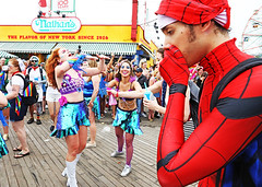 The moment when Spiderman realized he was actually just merely a human being. (kirstiecat) Tags: spiderman nathans nathanshotdogs coneyisland brooklyn nyc newyorkcity saturation colors colours women strangers costumes mermaids mermaidparade halloween