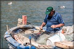"""Il (""""grande"""") Pescatore... (AndreaCT78) Tags: pescatore barca reti pesce mare"""