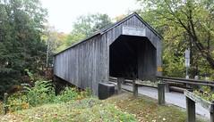 Kingsley Covered Bridge over the Mill River in North Clarendon, Vermont.  Built 1836 (lhboudreau) Tags: vermontinthefall bridge coveredbridge kingsleycoveredbridge water river millriver northclarendon vermont outdoor outdoors tree trees grass preservation historicpreservation historic sky wood wooden northclarendonvermont 1836 oldbridge plants shrubs wellworn autumn structure architecture