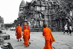 Buddhist monks at Angkor Wat Cambodia (Dave Russell (1.5 million views thanks)) Tags: monk monks color colors colour colours orange black white art arty angkor wat siem reap cambodia asia far east eastern temple building holy place religion architecture ancient old historic wonder world buddhism buddhist men male children child monastic bhikkhu travel tourism outdoor globe trek globetrekker dslr autofocus