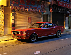 """""""mustang in hong kong"""" (hugo poon - one day in my life) Tags: xt2 23mmf2 hongkong wanchai springgardenlane mustang mustang289 ford vintage reminiscing vanishing emptystreet closed shop citynight colours lights 60s yesteryear yesterday memories red car couple"""