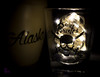 Real Pirates... of Alaska (4inthehouse) Tags: lights glass cup souvenir skull shotglass shot realpirates macromondays alaska mug lowkey whydahpiratemuseum