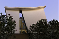 A Slice of Past (Giovanni Cappiello) Tags: leaf sky white watermark new architecture city facade green sguardidellacittà glass afternoon window smooth flower blue concrete building rome roma