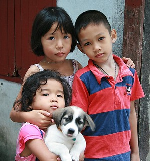 children with puppy
