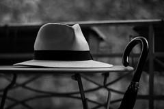 Whose Hat...? (Blues Views) Tags: collective52photoproject hat tabletopphotography table umbrella blackandwhite noiretblanc photographieennoiretblanc monochrome bokeh depthoffield