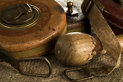 Tale Of The Tape (darrenball189) Tags: measure tool tape old equipment measurement work isolated vintage fabric instrument object industry construction tailor ruler reel closeup retro antique detail leather aged measuringtape macro carpentry objects steel tapemeasure rulertape measuretape wooden oldstyle oldfashioned textured craftsmanship retromeasure handle
