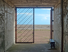Exit (harrytaylor6) Tags: door doorway clouds sky gravel ranges mod disused abandoned 1025fav orfordness hell birth death heaven