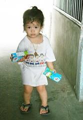 bringing home the milk (the foreign photographer - ฝรั่งถ่) Tags: cute girl child milk cartons khlong thanon portraits bangkhen bangkok thailand canon kiss