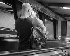 Up Escalator (John St John Photography) Tags: streetphotography candidphotography highstreet atrain mta newyorkcity newyork brooklynbridge man woman escalator lovers embrace affection bw blackandwhite blackwhite blackwhitephotos johnstjohn