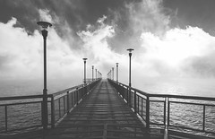 The Cold Walkway. (Pablin79) Tags: mist sky sunrise fog morning reflections winter water cold river sun light clouds blackandwhite white pier monochrome black shadows lines iron outdoors horizontal lanterns argentina runway misiones posadas