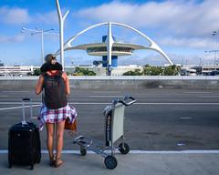 the seguidillas was beatable (bhautik_joshi) Tags: candid fromthehip people street streetphotography bhautikjoshi la losangeles lax airport luggage cart waiting california unitedstates us