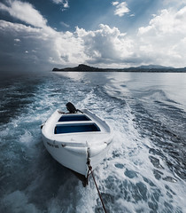 Cruising (Ray Moloney Photography) Tags: ifttt 500px mountains water boat greece blue light clouds cloudscape cloudy waves silhouette white small wave rope rhodes raymoloneyphoto
