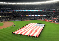 A giant American flag is unfurled at Yankee Stadium prior to Game 3 of the 2017 American League Championship Series. Shot with an iPhone 7 Plus. (apardavila) Tags: alcs americanleaguechampionshipseries americanflag baseballyankeestadium mlb majorleaguebaseball newyorkyankees yankees yanks flag postseason sports