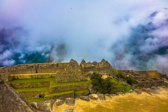 Machu Picchu with some lifting clouds for texture.