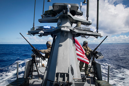 Sailors provide force protection as the aircraft carrier USS Theodore Roosevelt transits Apra Harbor, Guam