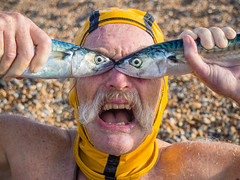 Dave Sawyers fish face again (lomokev) Tags: beach fish fishface mackerel postedtoinstagram postedtoflickr brighton england unitedkingdom gb file:name=170718omdem57180012 olympusomdem5 olympus omd em5 olympusomd portrait crazy funny