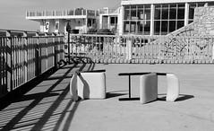 Chaises mortes (ZUHMHA) Tags: wall mur marseille france monochrome chair chaise fence grille grillage barrière soleil sun ombre lumière light shadow line ligne courbe curve geometry géométrie water sea mer eau sky ciel nuages cloud front de letter lettre sign