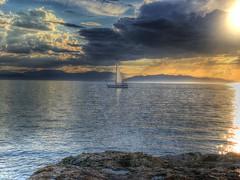 Near the end of the day_IMG_1139n (AchillWandering) Tags: sunset boat sea island aegina greece nature dream coast golden ciel blue naturephotography water rocks