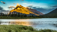 Banff Alpenglow (lsten) Tags: grass natureview amazing nature water mystical lake wideangle theunforgettablepictures haze banffnationalpark summer beach f18 iconic landscapephotography canoneos5dmarkiv viewingpoint sky vermilionlakes view tripod nisifilters trees formatthitechcolbybrownsignature 28mm travelphotography goldenhour graduatedndfilter beforesunset alpenglow majestical nationalpark mountains iso100 singleshot naturephotography magnificent landscape clouds amateurphotography canada alberta colorful scenery beautiful banff nisicpl canonef1635mmf4lisusm golden colors green peaceful formatthitech shore mountain