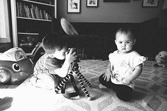 When your brother thinks he's Mario Testino.... (ditakespictures) Tags: kids blackandwhite toddler baby siblings