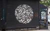 Bad Habit Man (UrbanphotoZ) Tags: badhabitman graffiti blackandwhite black gate circle pattern extension stickers jukely investinlivingartists youcanflywithus window awning chinatown lowereastside manhattan newyorkcity newyork nyc ny