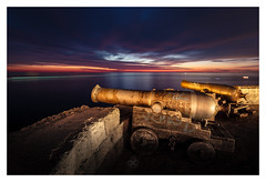The Old Guard (picturedevon.co.uk) Tags: monopoli italy europe sunrise seaascape colour le longexposure cannons seawall sea light red orange gold coast morning lighttrail boats sky cloud water picturedevoncouk