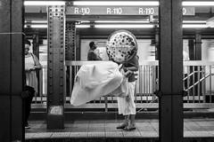 R-110 (John St John Photography) Tags: streetphotography candidphotography atrain 34thstreet subwaystation mta newyorkcity newyork platform woman passengers commuting balloon happy birthday bw blackandwhite blackwhite blackwhitephotos johnstjohn