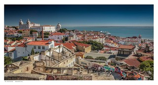 Lisbon panorama showing cruise ship & tourist group with their guide.