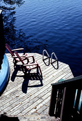 Cottage Dock on Solitaire Lake (Bill Smith1) Tags: believeinfilm billsmithsphotography heyfsc kodakektar100 limberlostnaturepreserve muskoka olympusom2n zuikomc50f18lens